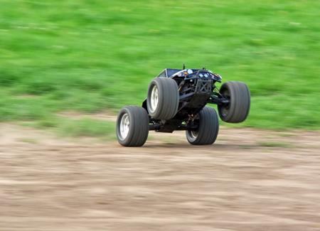 Powerfull radio controlled car speeding on the grass photo