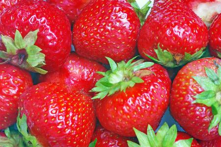 Fresh strawberry as background, close up image