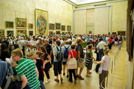 PARIS, FRANCE - AUGUST 03  Group of tourists gathered around the Mona Lisa in the Louvre Museum on August 03, 2008 in Paris, France