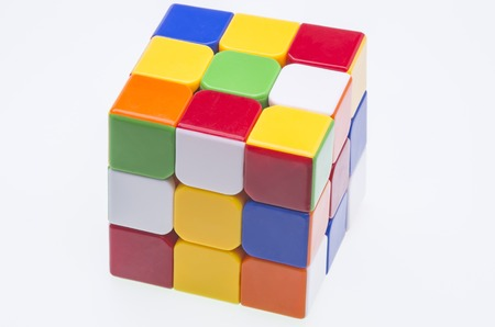 unsolved: Close image of a scrambled Rubik Editorial
