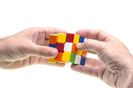 resolving: Hands resolving a Rubik Editorial