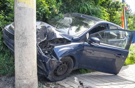 Hard crushed car in the city, frontal damage
