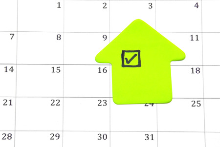 Close up image of a green checklist on a calendar.