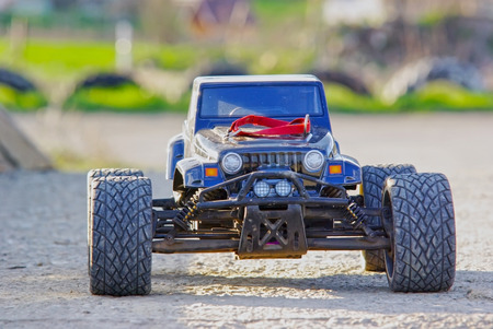 Playing with a radio controlled car. Powered by powerful dual electric motors, these remote controlled monster trucks provide high performance. These monster trucks can reach 100 kmh without problems. photo
