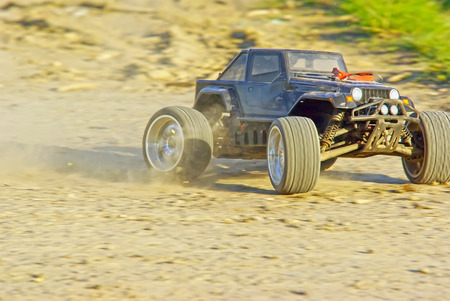 4wd: Speeding radio controlled car on the ground.