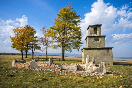 Old construction ruin in a beautiful autumn day. photo