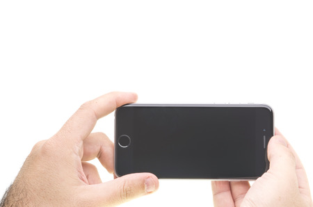 New Apple iPhone 6 holding in hands.