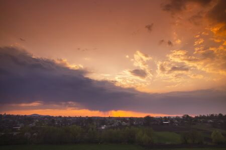 orange sunset: Orange sunset in a small village