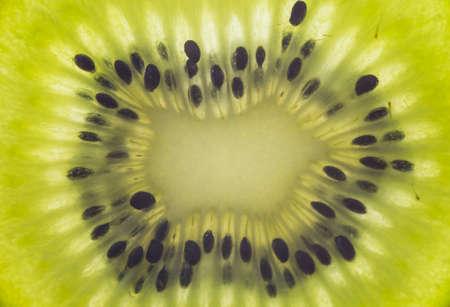 Close up image of a slice of kiwi fruit
