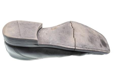 sole: Damaged sole of a black shoe isolated Stock Photo