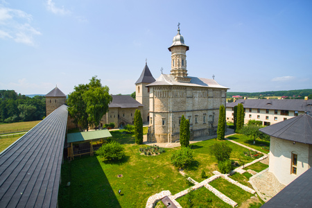 Church of Dragomirna Monastery surrounded by stone walls, for defending in medieval period. Editorial