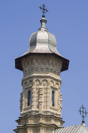 Church bell tower of Dragomirna Monastery, close-up image. The sculptures decorating the tower made in stone, part of Unesco heritage