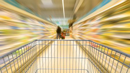 Shopping cart speeding in the supermarket aisle