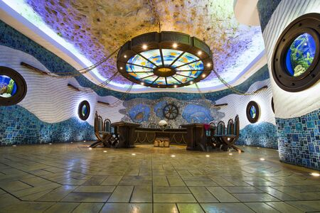 CRICOVA, MOLDOVA - NOVEMBER 13, 2018: Wine tasting room called Seabed in Cricova Winery. Cricova winery is a popular touristic attraction for his famous wine cellars. It has 120 kilometers of labyrinthine roadways in the underground. Editorial