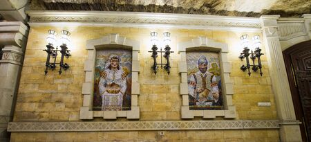 CRICOVA, MOLDOVA - NOVEMBER 13, 2018: Underground wine gallery, mosaic windows in Cricova Winery. Cricova winery is a popular touristic attraction for his famous wine cellars. It has 120 kilometers of labyrinthine roadways in the underground.