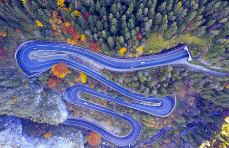 Above view of a curvy road through autumn forest in a canyon. Bicaz gorge is a narrow pass between two historical Romanian region.