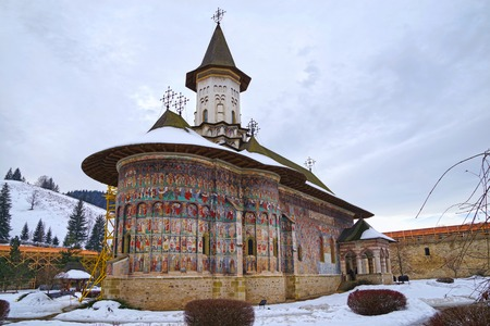 Painted church of Sucevita monastery was built in 1585 and paintings date around 1601. The walls are under repair and partial covered in ugly scaffolding,