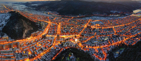 Aerial view of city lights in winter evening. Aerial panorama of Piatra Neamt in Romania