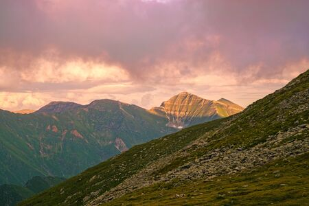 Fagaras mountain crest in a summer landscape, sunset color Stock Photo - 129469168