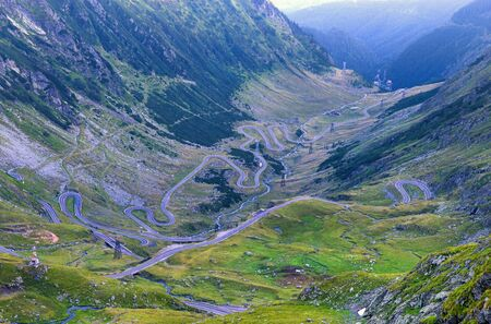 Winding road in summer mountains, Transfagarasan road in Romanian Carpathians