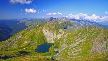 Fagaras Mountains in Romania, summer view from the top, Capra Lake and Transfagarasan road Archivio Fotografico - 129468965