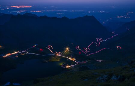 Spectacular mountain road in the night, lights on winding road, Transfagarasan road in Romania, night scene 写真素材