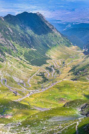 Spectacular curvy Transfagarasan road in Romania, summer landscape in Romanian Carpathians Archivio Fotografico - 129468984