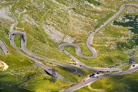 Many cars on Transfagarasan highway road in the summer, Fagaras Mountains in Romania Archivio Fotografico - 129468887