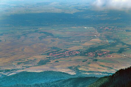 Aerial view from the top of Fagaras Mountains, summer villages and fields 免版税图像