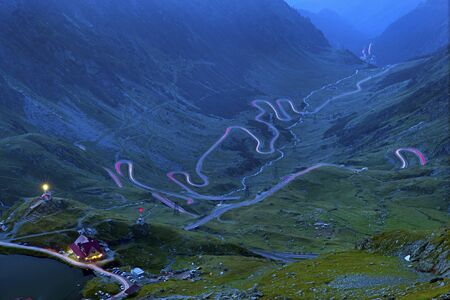 Long exposure picture winding road in mountains, Transfagarasan road in Romanian Carpathians.