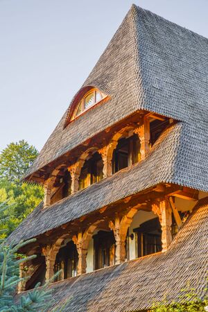 Traditional romanian architecture  in Maramures county, wwoden house at sunset.