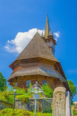 Representative wooden church in Maramures (Romania)  from Budesti, built in 1643 and listed by Unesco as World Heritage Site Stock Photo