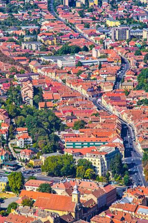Aerial view of Brasov city in Romania, street and ancient buildings