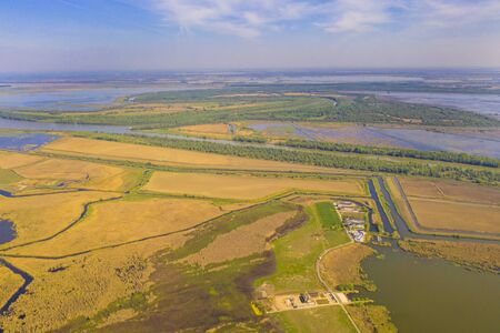 Aerial view of Danube Delta, flat field and water canals, Unesco Heritage Site