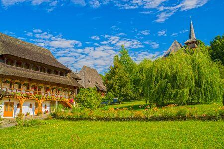 Barsana monastery house in the middle of nature. Barsana monastery is an important landmark in Maramures area (Romania) 스톡 콘텐츠