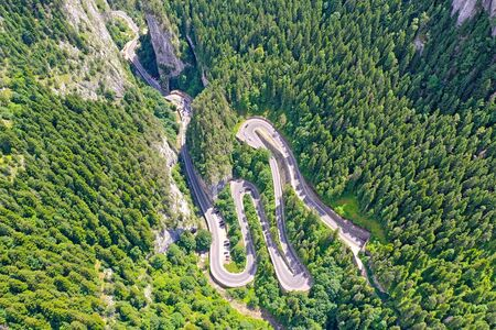 Rocky mountain and winding road, above view Bicaz Gorges in Romanian Carpathians.