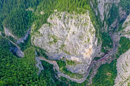 Rocky mountain pass in Romanian Carpathians, highway road near huge rocks