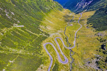 Above view of curvy road in Romanian Carpathians, summer view, Transfagarasan road in Romania