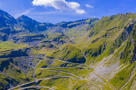 Aerial view of winding road in Romanian Carpathians, summer view of Transfagarasan road in Romania Stock fotó - 133251812