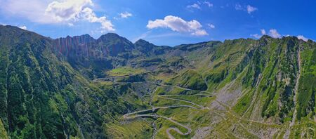 Aerial view of winding road in Romanian Carpathians, summer view of Transfagarasan road in Romania Imagens
