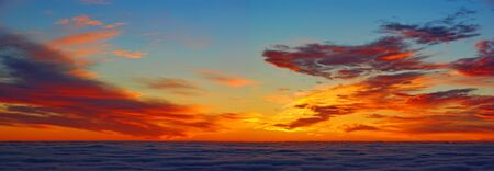 Sunrise panorama above clouds, Orange clouds in the morning, before sunrise Banco de Imagens