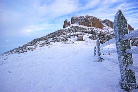 Frozen wood fence and mountain landscape in Romanian Carpathians Stock Photo