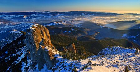 Mountain panorama from the top in winter, aerial panorama in Romanian Carpathians.