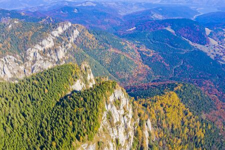 Aerial view of autumn rocky mountain in Romanian Carpathians.