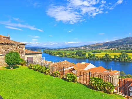 Summer landscape of Tui village and Minho river to Portugal Stock Photo