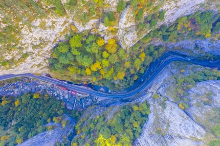 Gorges mountain road in autumn viewed from above.This stunning gorge has a part that is so narrow that it is called The neck of Hell. The road is a passageway between Romanian provinces Moldova and