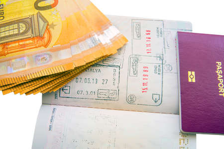 Euro banknotes and passport visa stamps Archivio Fotografico