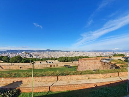 Ancient walls of Montjuic Castle and Barcelona panorama