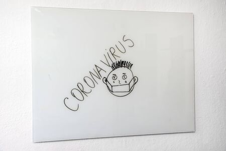 Coronavirus and scarry face on white board