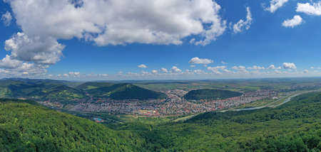 Aerial view of green mountain city, summer landscape of Piatra Neamt city in Romania